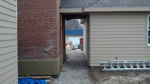 This is the 4' breezeway connecting the new 3 car garage to the smokehouse entrance.  It will have a gated entrance with a trellis as you enter from the back of the home.